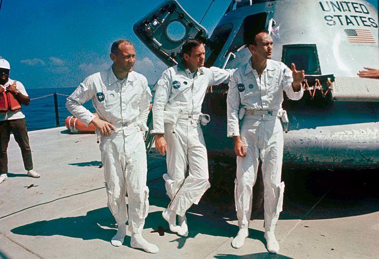 Aldrin, Armstrong en Collins naast de Apollo 11 Beeld AP