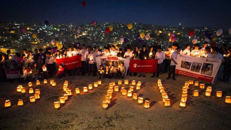 Een internationale actie voor Syrië half maart. Kinderen over de hele wereld hielden een minuut stilte. Beeld anp