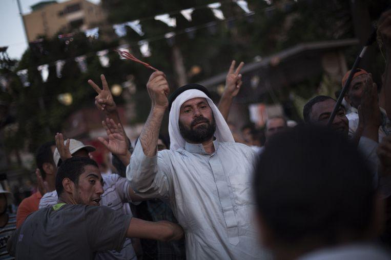 Aanhangers van de Moslim Broederschap gisteren in Caïro. Beeld AP