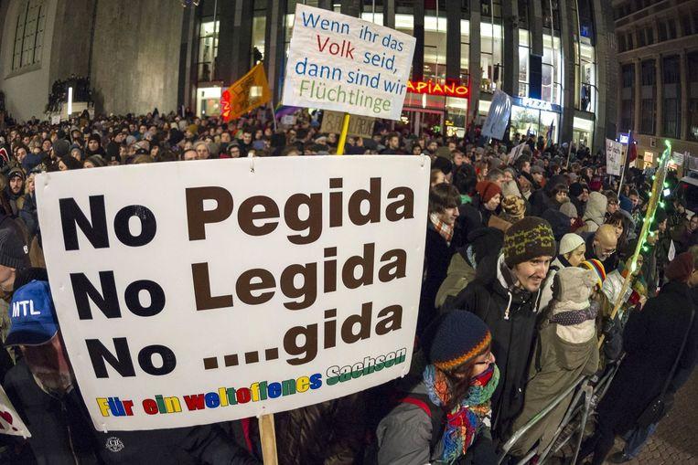 Demonstratie tegen de anti-Islambeweging Pegida in Duitsland. Beeld anp