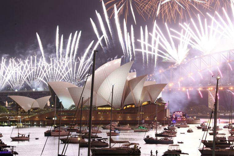 Vuurwerk boven het Opera House in Sydney. Beeld Getty Images