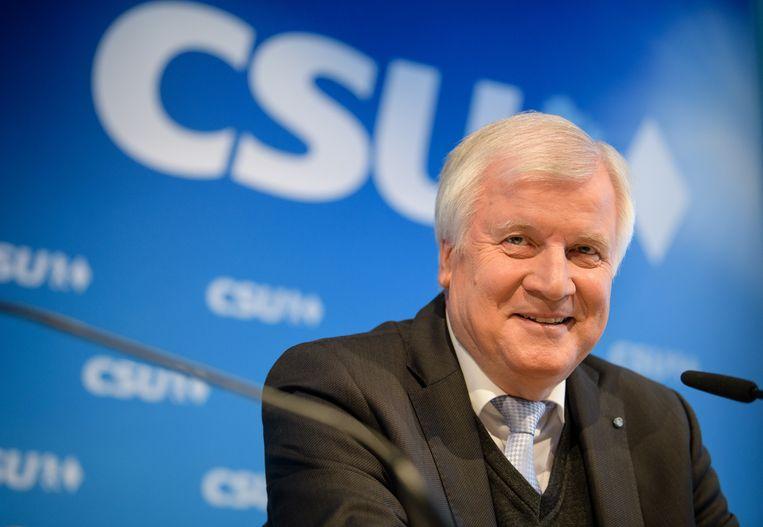 Horst Seehofer (CSU) uit Beieren, weldra minister van Heimat, op voorwaarde dat het Duitse regeerakkoord erdoor komt.  Beeld Matthias Balk/dpa