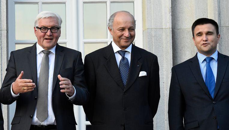 Buitenlandministers van Duitsland (Frank-Walter Steinmeier), Frankrijk (Laurent Fabius) en Oekraïne (Pavlo Klimkin). Beeld AP