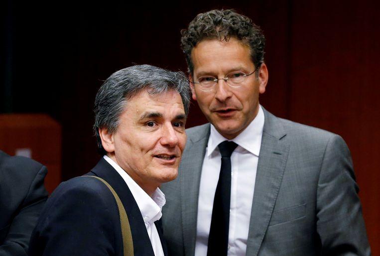 Eurogroepvoorzitter Jeroen Dijsselbloem (R) met de Griekse minister van Financiën Efklidis Tsakalotos (L), die zich een betrouwbare partner toont.<br /> Beeld REUTERS