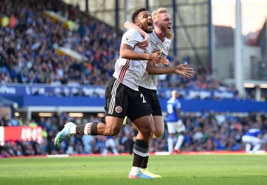 Lys Mousset en Oliver McBurnie vieren de 0-2 van Sheffield United.