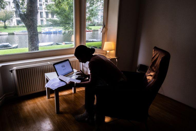 Thuiswerken in Amsterdam. Beeld Joris Van Gennip
