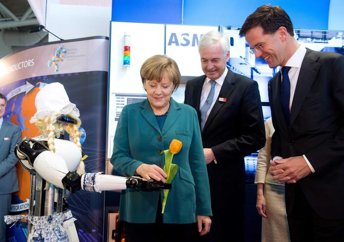Marc Hendrikse samen met Angela Merkel en Mark Rutte op de Hannover Messe in 2014.