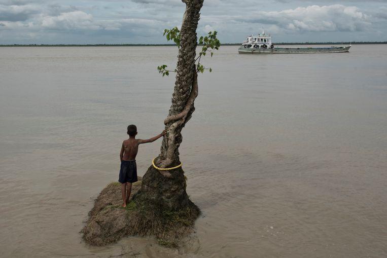 Het Indiase eiland Ghoramara verdwijnt door de stijging van de zeespiegel. Beeld Getty Images