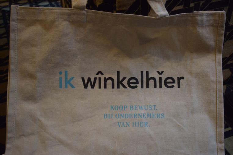 Een boodschappentas van de 'winkelhier'-campagne Beeld BELGAONTHESPOT