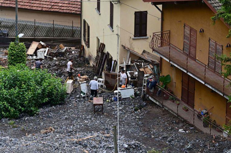 Schade na wateroverlast in de gemeente Laglio, bij het Comomeer.  Beeld AFP
