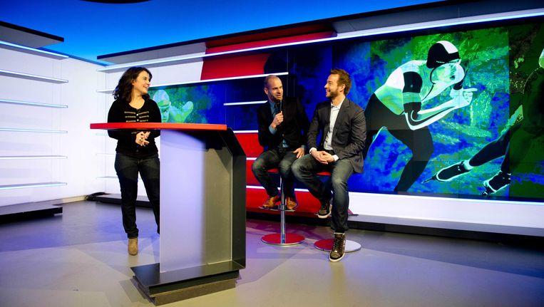 Presentatoren Dione de Graaff, Erben Wennemars en Henry Schut tijdens de presentatie van de NOS van hun plannen voor het sportjaar 2014. Beeld ANP Kippa