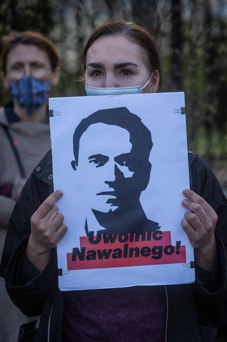 'Poetin zal Navalny laten lijden, door verwaarlozing of door iets sinisters. Zijn overlevingskansen lijken nu gering.'  Beeld AFP