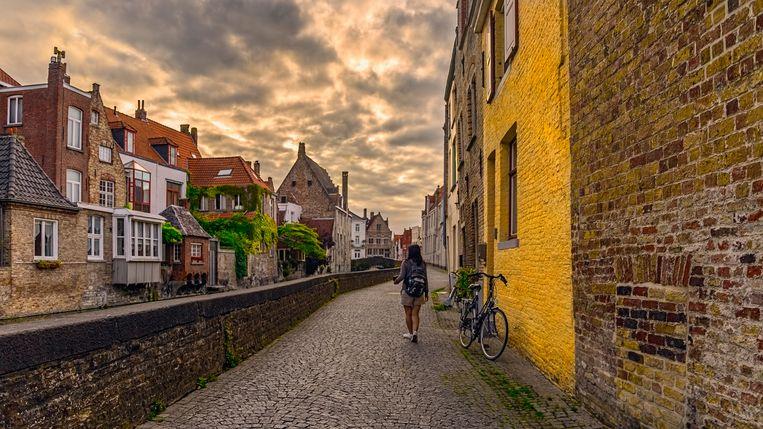 Ook in Brugge is het nog steeds rustig. 'De tijd dat reizen zo goed als gelijk stond aan zorgeloosheid is voorbij', zegt Van der Borg.  Beeld Getty Images