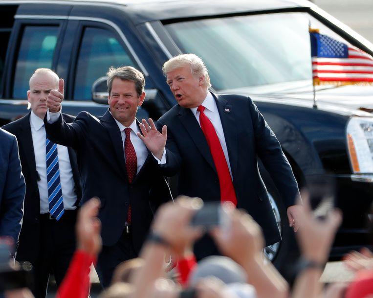 Brian Kemp en Donald Trump op archiefbeeld in Georgia. Beeld AP
