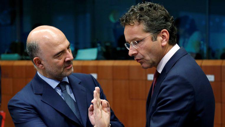 Eurocommissaris Pierre Moscovici en Eurogroepvoorzitter Jeroen Dijsselbloem. Beeld REUTERS