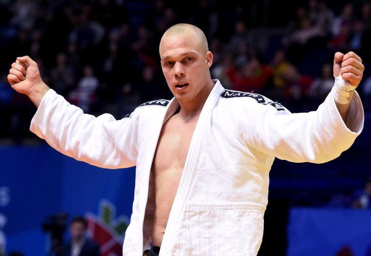 Judoka Henk Grol viert zijn gouden medaille tijdens de Europese kampioenschappen in Rusland in april 2016. Beeld AFP