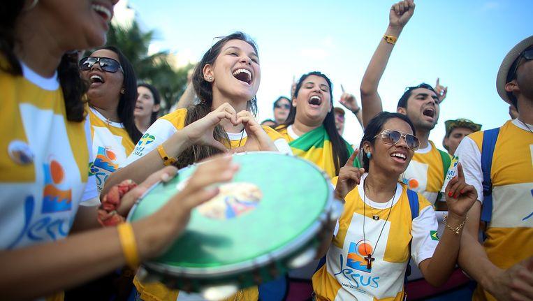Deelnemers aan de Wereldjongerendagen in Brazilië. Beeld Getty Images