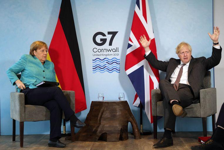 De Duitse bondskanselier Angela Merkel en de Britse premier Boris Johnson. Beeld Photo News