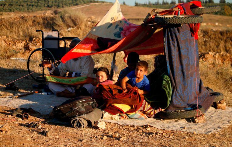 Kinderen in een kamp nabij het Zuid-Syrische Nasib. Beeld AFP