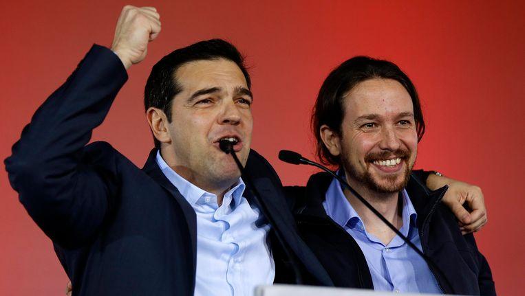 De Griekse premier Alexis Tsipras en de Spaanse Podemos-voorzitter Pablo Iglesias Beeld REUTERS