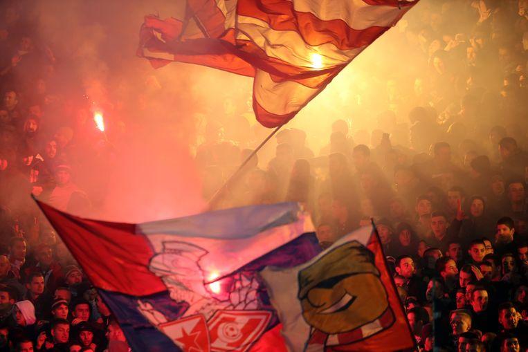 Supporters van voetbalclub Rode Ster Belgrado. Beeld EPA