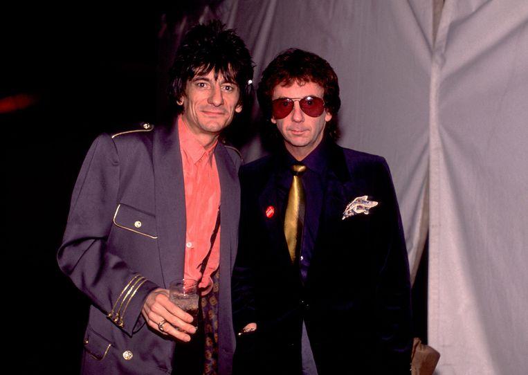 Spector (rechts) met Rolling Stone Ron Wood. Beeld WireImage