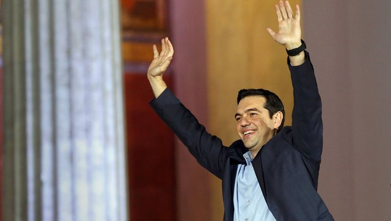 Een glunderende Syriza-leider Alexis Tsipras in Athene. Beeld REUTERS