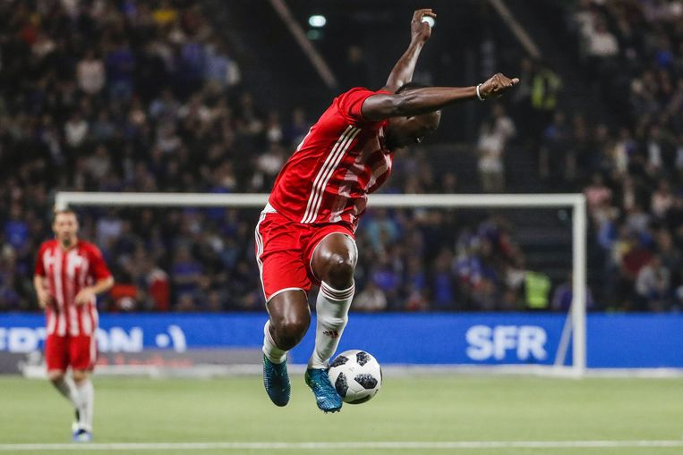 Usain Bolt tijdens een  demo-wedstrijd. Beeld AFP