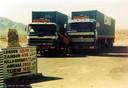 Twee wagens van  Rynart Trucking bij Quetta in Pakistan, rond 1972. Op de foto staat Henk Rynart, de broer van Rinus.