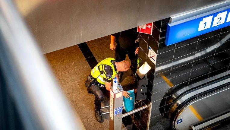 Hulpdiensten in actie na de aanslag. Beeld anp
