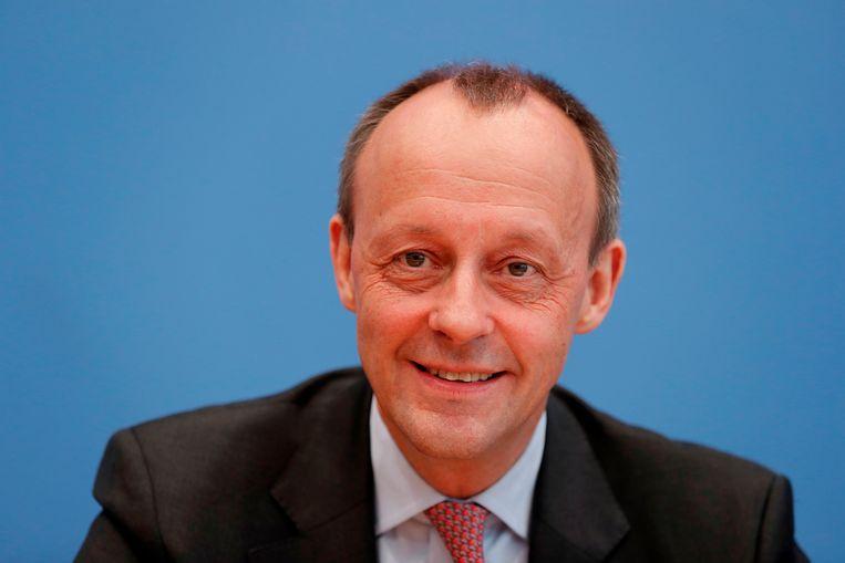 De conservatieve Friedrich Merz is favoriet om Angela Merkel op te volgen.  Beeld AFP