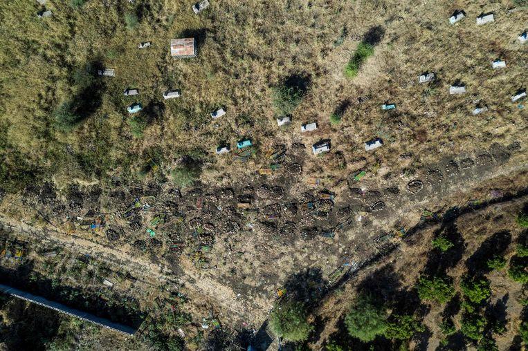 Massagraven in Mai Kadra in Ethiopië waar honderden bewoners werden vermoord. Beeld AFP