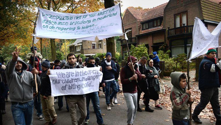 Asielzoekers in Heumensoord protesteren tegen hun verblijfsomstandigheden. Beeld Marcel van den Bergh / de Volkskrant