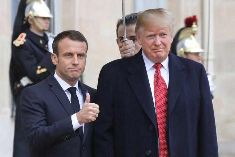 Frans president Emmanuel Macron en zijn Amerikaanse collega Donald Trump. Beeld AFP