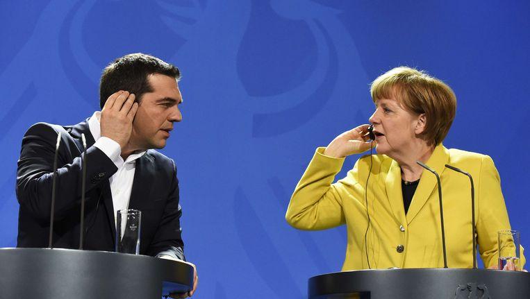 Alexis Tsipras en Angela Merkel eerder dit jaar in Berlijn. Beeld AFP