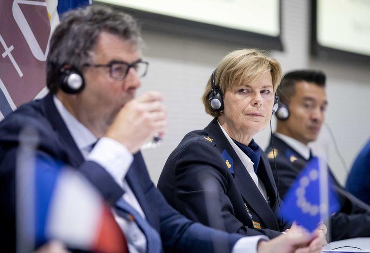 John Lucas (hoofdofficier van justitie Landelijk Parket) en Jannine van den Berg (politiechef Landelijke Eenheid). Beeld ANP