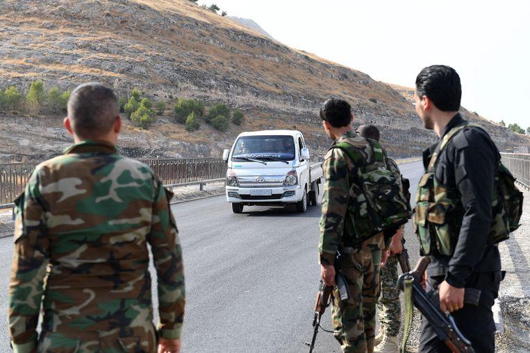 Syrische regeringssoldaten nabij de Turkse grens. Beeld AFP