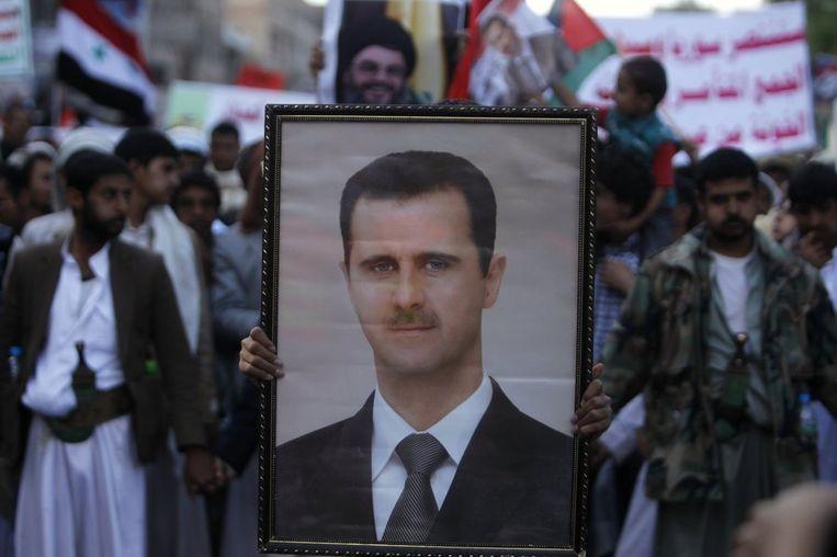 Protesten van Assad-aanhangers tegen mogelijke interventie. Beeld reuters