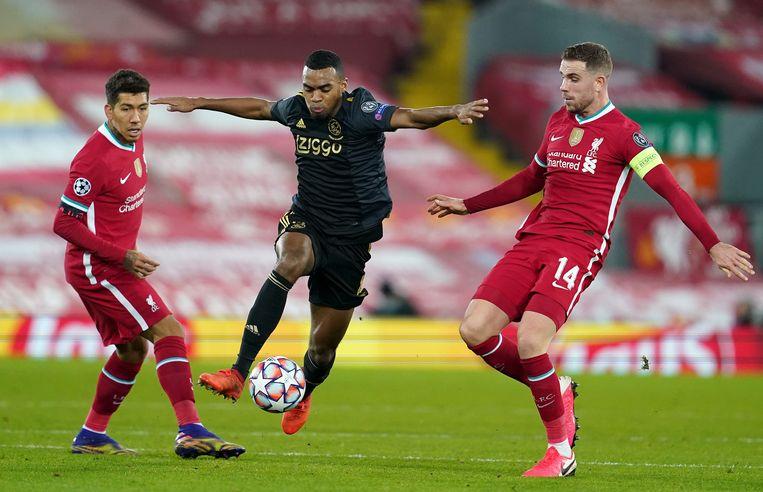 Ryan Gravenberch in actie tegen Liverpool in de Champions League. Beeld Getty Images