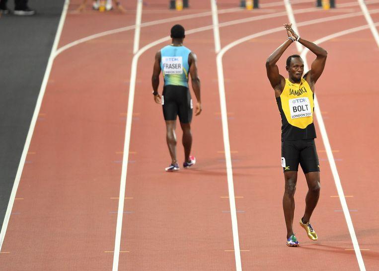 Usain Bolt op het WK in Londen. Beeld Photo News
