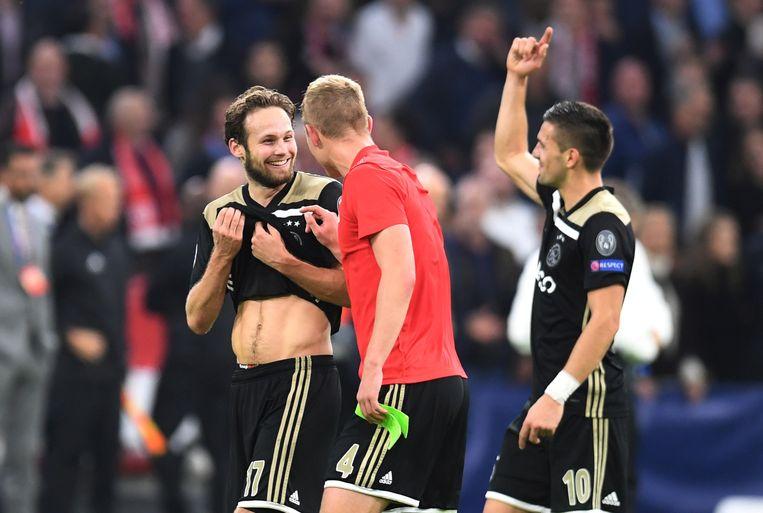 Ajax-spelers Daley Blind, Matthijs de Ligt en  Dusan Tadic. Beeld REUTERS