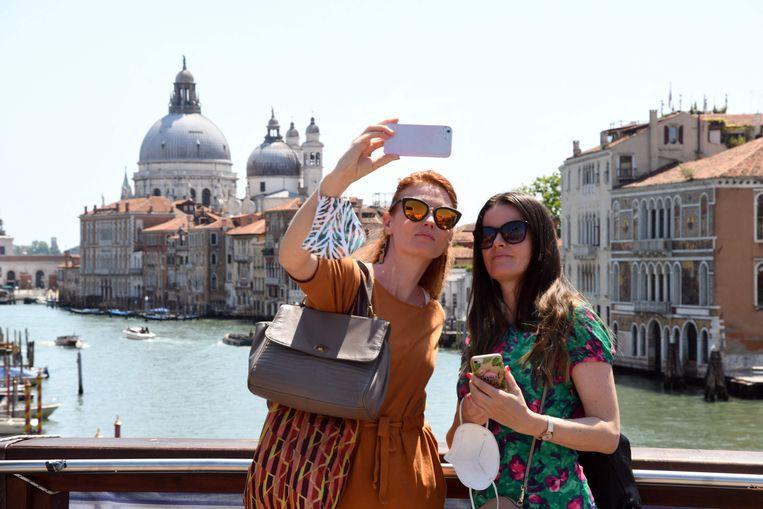 Amerikaanse toeristen in Venetië. Wat Brussel betreft zijn ze weer welkom in de hele EU. Beeld AFP