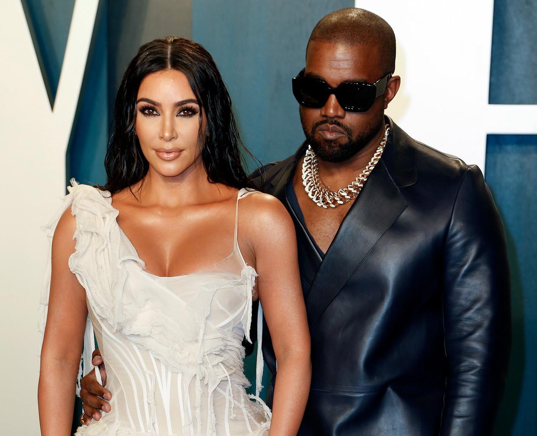 Kim Kardashian en echtgenoot Kanye West, op de Vanity Fair Oscar Party in februari dit jaar. Als alles volgens plan verloopt, is ze over twee jaar advocate. Beeld EPA