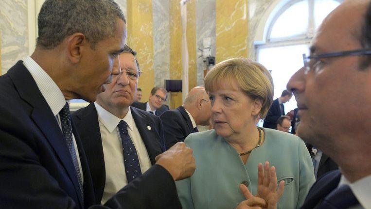 De Amerikaanse president Barack Obama en de Duitse bondskanselier Angela Merkel. Beeld anp