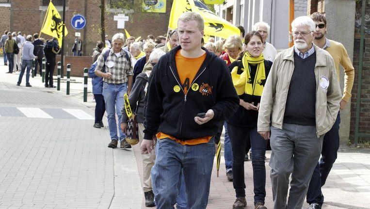 Het TAK protesteert in Sint-Genesius-Rode. Beeld BELGA