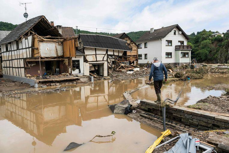 Verwoeste woningen in Schuld Beeld AFP