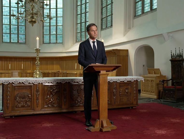 Premier Mark Rutte achter het kansel. Beeld RVD