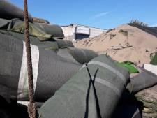Dongen gaat verbrande kunstgrasmatten Tuf ruimen