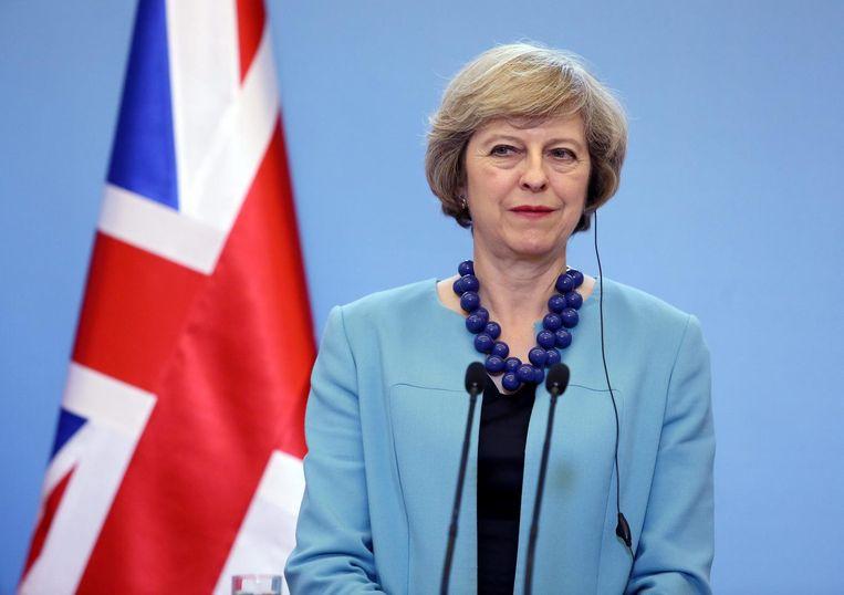 Britse premier Theresa May tijdens een persconferentie over de gevolgen van Brexit. Beeld EPA