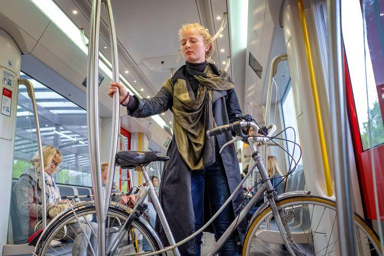 Reizigers in de Amsterdamse Noord/Zuidlijn Beeld Patrick Post